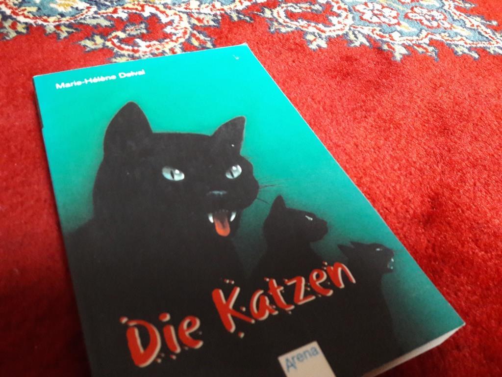 """Cover zu """"Die Katzen"""", zeigt drei Katzen"""